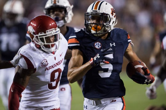 Auburn's Anthony Schwartz (5) runs the ball down the sideline against Arkansas at Jordan-Hare Stadium in Auburn, Ala., on Saturday, Sept. 21, 2018. Auburn defeated Arkansas 34-3.