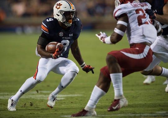 Auburn's Kam Martin (9) runs the ball down the field against Arkansas at Jordan-Hare Stadium in Auburn, Ala., on Saturday, Sept. 21, 2018. Auburn defeated Arkansas 34-3.