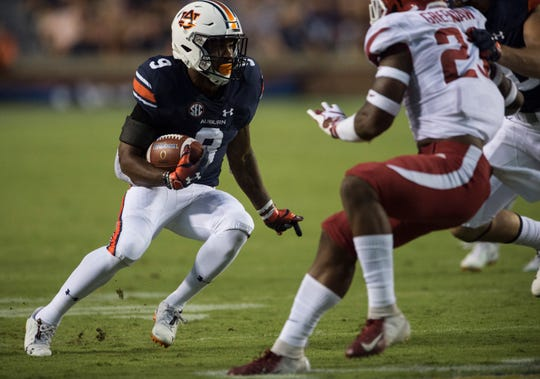 Auburn's Kam Martin (9) runs the ball down the field against Arkansas at Jordan-Hare Stadium in Auburn, Ala., on Saturday, Sept. 21, 2018. Auburn defeated Arkansas 34-3.