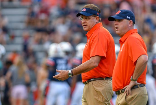 Auburn head coach Gus Malzahn and offensive coordinator Chip Lindsey talk before the Arkansas game Saturday, Sept. 22, 2018, at Jordan-Hare Stadium in Auburn, Ala.