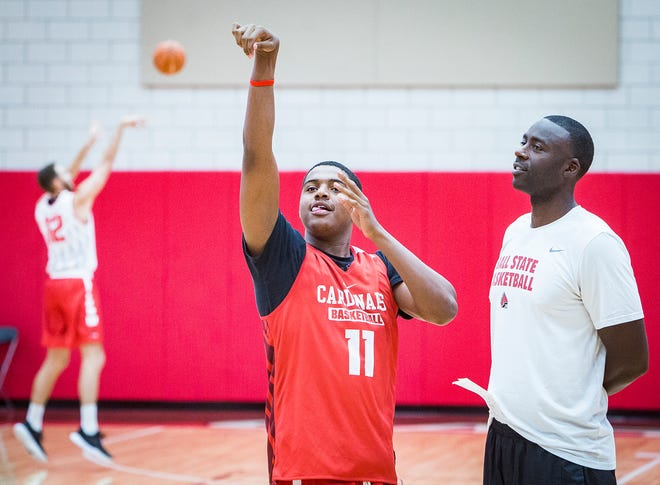Former Ball State assistant coach Brian Thornton, right, works with Jarron Coleman during practice on Sept. 25, 2018.
