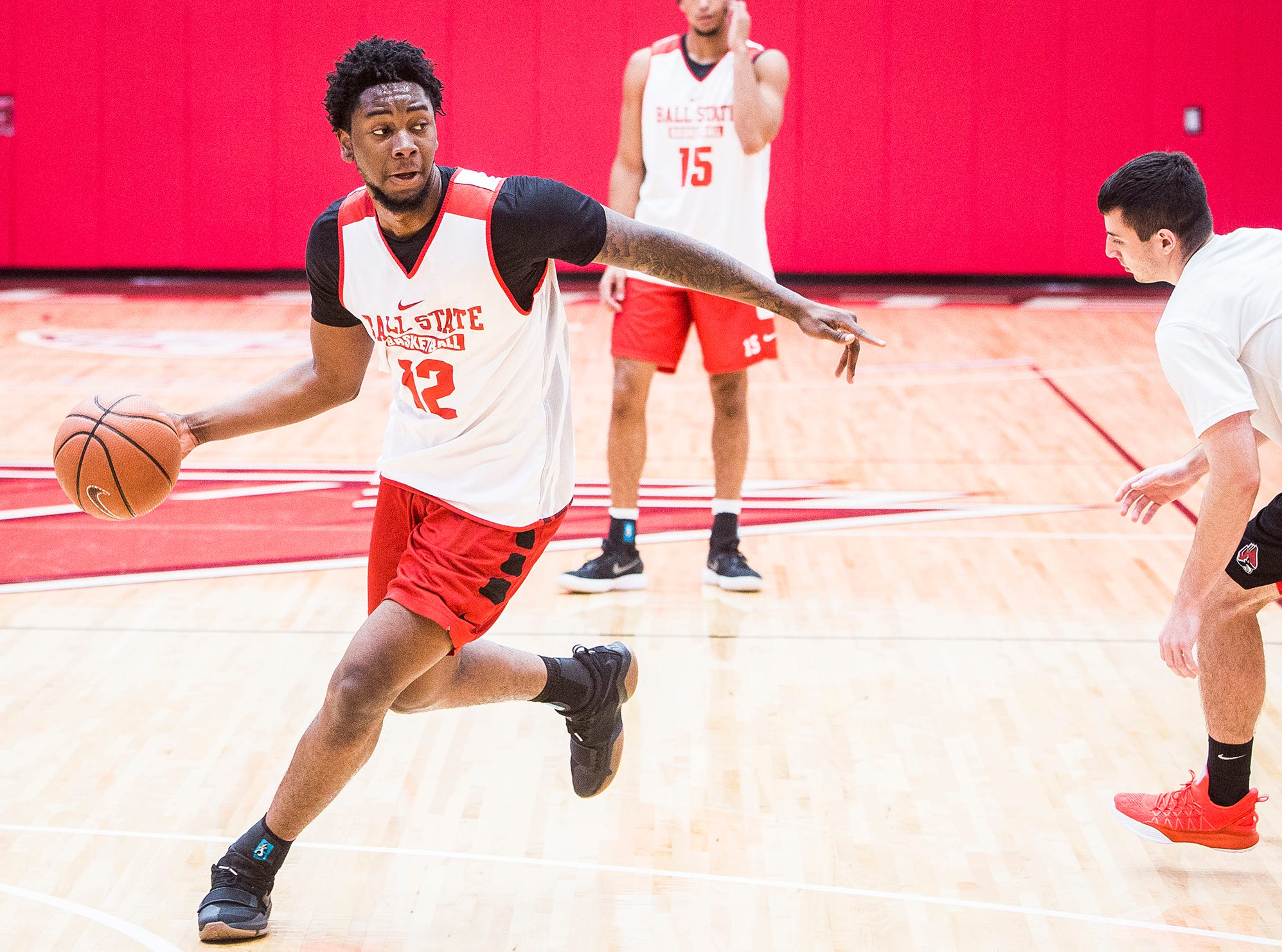 Ball State's Kani Acree works on defense with teammates during their first open practice Tuesday, Sept. 25, 2018.