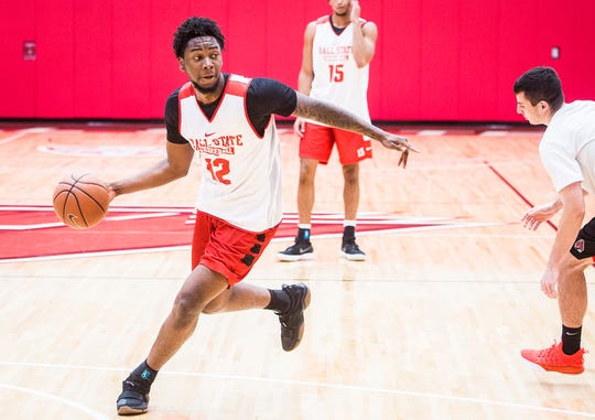 Ball State's Kani Acree makes a pass during their first open practice Tuesday, Sept. 25, 2018.