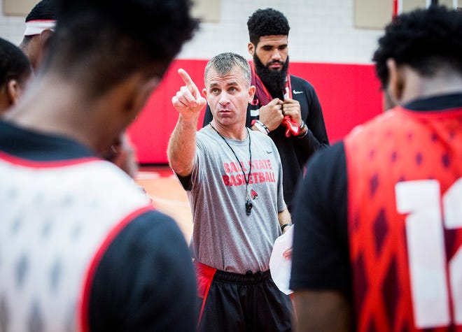 FILE -- Ball State head basketball coach James Whitford addresses his team during a practice Tuesday, Sept. 25, 2018.