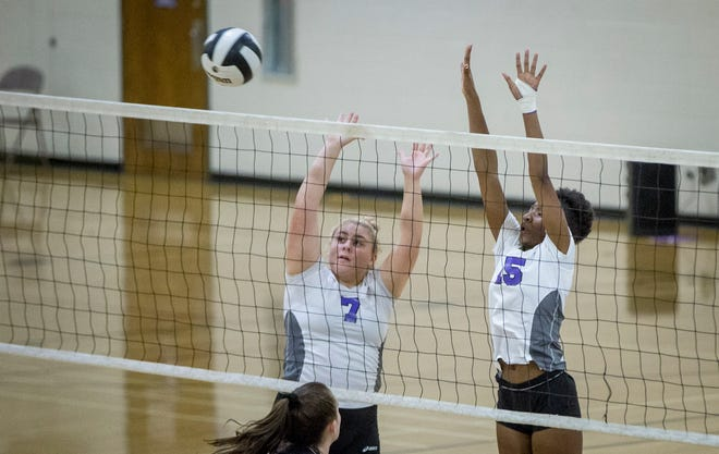 Central's McKenna McNabb, left, and Taydriana Robertson go up for a block against Wapahani Monday night at Muncie Central High School.