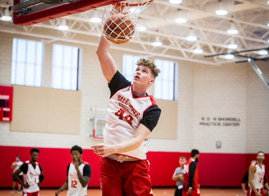 Ball State's Blake Huggins dunks the ball during their first open practice Tuesday, Sept. 25, 2018.