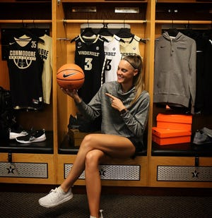 Former Tennessee Lady Vols player Kortney Dunbar poses in the Vanderbilt women's basketball locker room as a new graduate assistant for the Commodores.