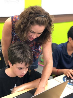 August James, pictured with her son, Evan, opens Code Ninjas in Franklin on Oct. 13, to provide more coding programs for kids.