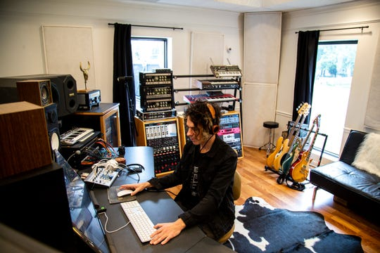 """Matt Mahaffey looks over his work at his recording studio Tuesday, Sept. 25, 2018, in East Nashville. Mahaffey toured with Beck, created the Expedia.com jingle and is now making music for the new """"Ninja Turtles"""" series."""
