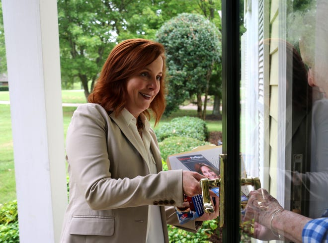 House candidate Rebecca Purington gives a flyer to a Brentwood resident on Sept. 13, 2018.
