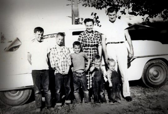 Ann and Joe Taff, right, with their five sons in front of the family Ford Fairlane around 1957. Russ Taff, 4, is the second from the right.