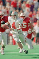 Ohio State quarterback Kirk Herbstreit, shown here playing against Wisconsin in 1992, led the Buckeyes to a 13-13 tie against Michigan later that season.