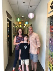 August and Jeff James, pictured with their son, Evan, open Code Ninjas in Franklin on Oct. 13, to provide more coding programs for kids.