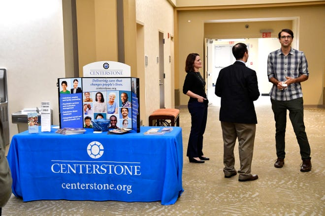 Nashville Storytellers pick up information about mental health at the Centerstone booth after storytellers addressed the stigma of mental health through sharing of their personal experiencesMonday Sept. 24, 2018, in Nashville, Tenn.