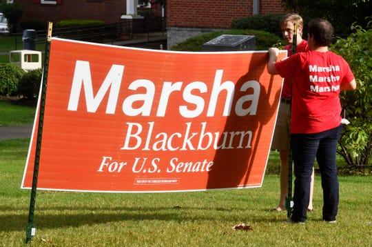 Marsha Blackburn supporters put up a sign before a U.S. Senate debate Tuesday, Sept. 25, 2018, at Cumberland University in Lebanon.