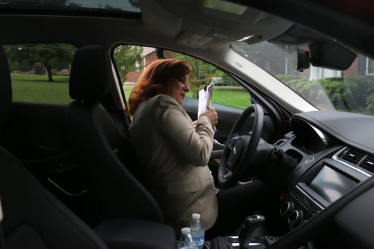 State House candidate Rebecca Purington gets out of her car to knock on the door of a potential voter off Wikle Road West in Brentwood on Sept. 13, 2018.
