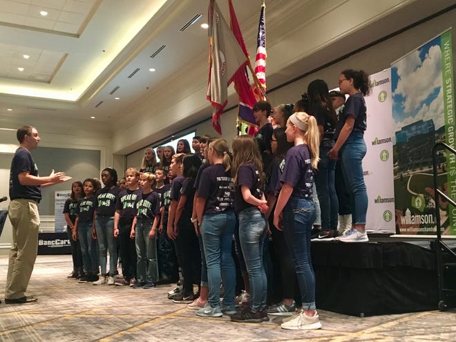 The Poplar Grove Middle School choir sings the national anthem during the State of the Schools address in Williamson County on Tuesday, Sept. 25, 2018.