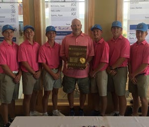 The DCHS golf team and coach Jay Powlas after winning the region tournament, qualifying them for the state championship tourney.