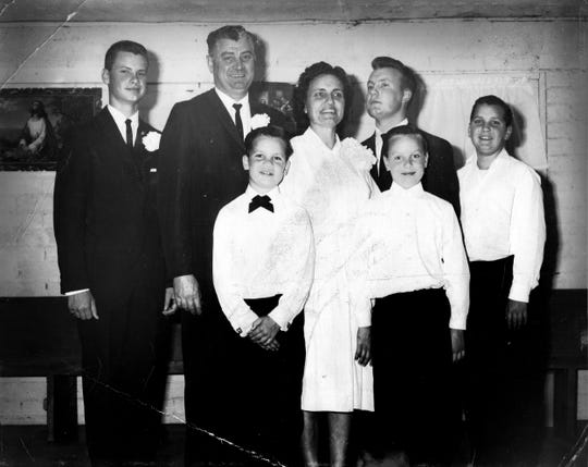 A family photo of the Taff family in Farmerville, California, around 1960, when Russ, in a white shirt and black bowtie, was about 7, shortly before he first saw his father drunk for the first time.