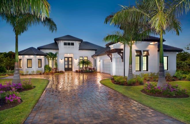 The Normandy II by Stock Signature Homes is one of two furnished models available immediately at Quail West.