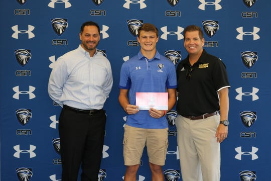 Dylan McNamara receives his official invite to the freshman All-America game. From left: CSN football coach Paul Selvidio, Dylan McNamara and All-American Games vice president Steve Quinn.