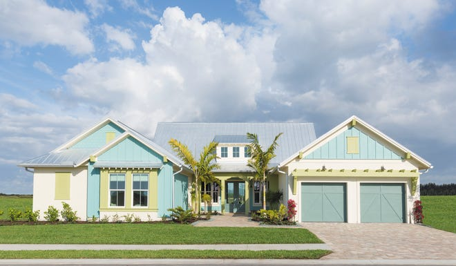 The Minorca by Ashton Woods in the Sparrow Cay neighborhood at Naples Reserve.