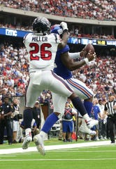 Sep 23, 2018; Houston, TX, USA; New York Giants linebacker Alec Ogletree (52) intercepts the ball in the end zone during the fourth quarter against Houston Texans runinng back Lamar Miller (26) at NRG Stadium.