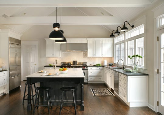 This kitchen in Allendale, designed by Thyme & Place Design in Wyckoff, features countertops from Stone Surfaces in East Rutherford and subway tile from Wayne Tile in Ramsey.
