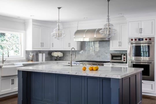 This kitchen in Demarest, designed by Designer Kitchens by Schneider, features Artistic Tile backsplashes and Signature Custom Cabinetry cabinets.