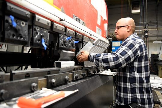 Alejandro Goycochea of Paterson is forming a MediTray sterilization basket using a press brake in the manufacturing facility at Case Medical, Inc. in South Hackensack, NJ on Tuesday, September 25, 2018.