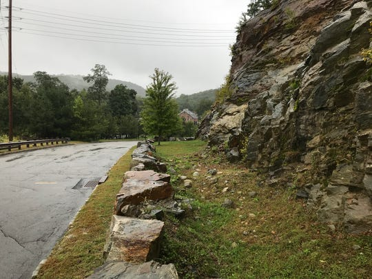 A rock wall along Overlook Drive in Riverdale pictured Sept. 25, 2018. In 2011 a massive rock slide here closed down the road for three days, sealing off 31 homes until a temporary road was constructed off High Street in Butler.