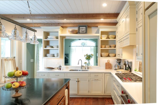 This Kitchen in Wyckoff, designed by Signature Kitchens, features shaker-style cabinets and 36-inch Wolf range top.