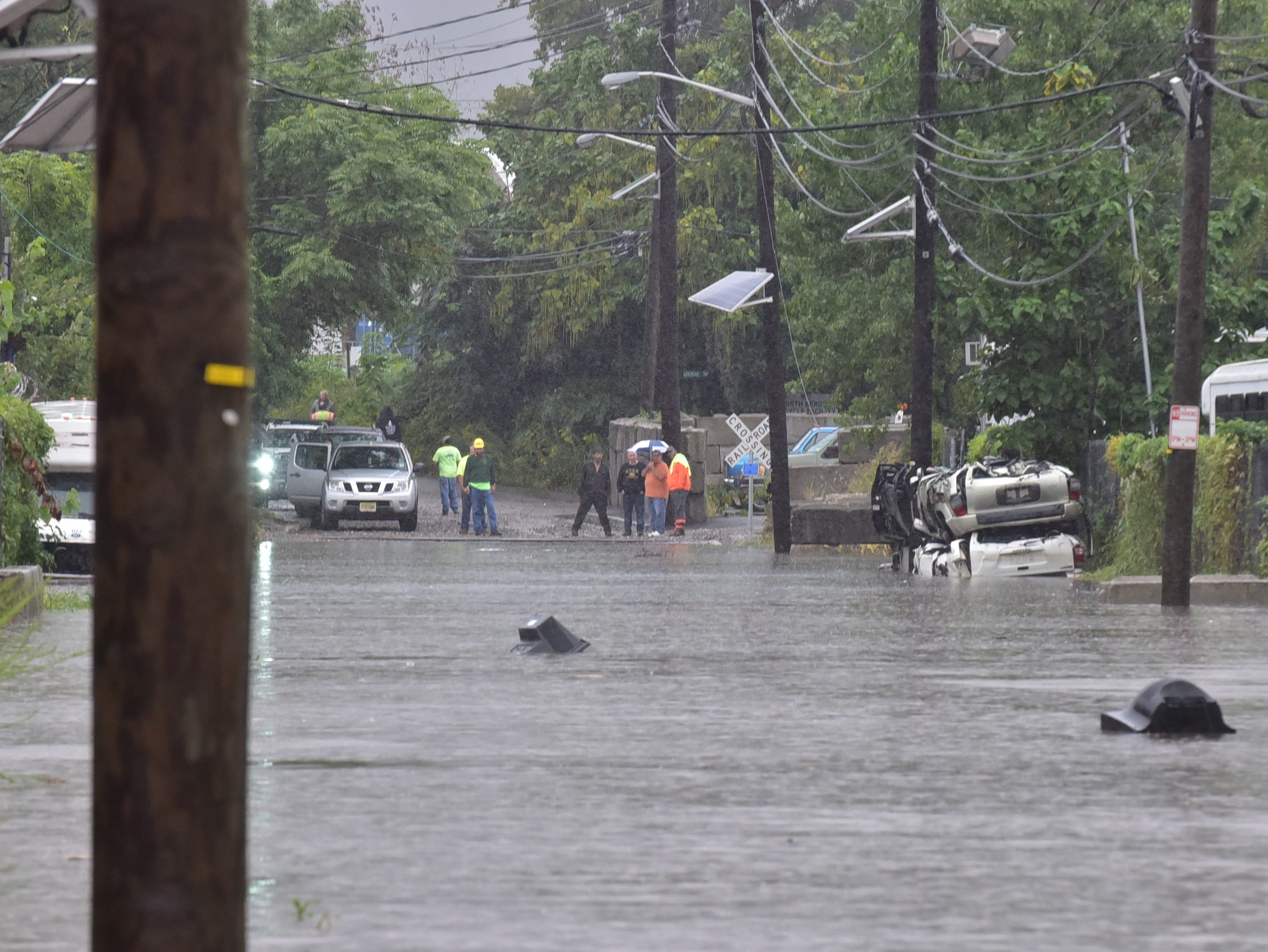 Heavy rain flooded Fairview Avenue at an Industrial Park in Fairview, stranding workers with no way out.