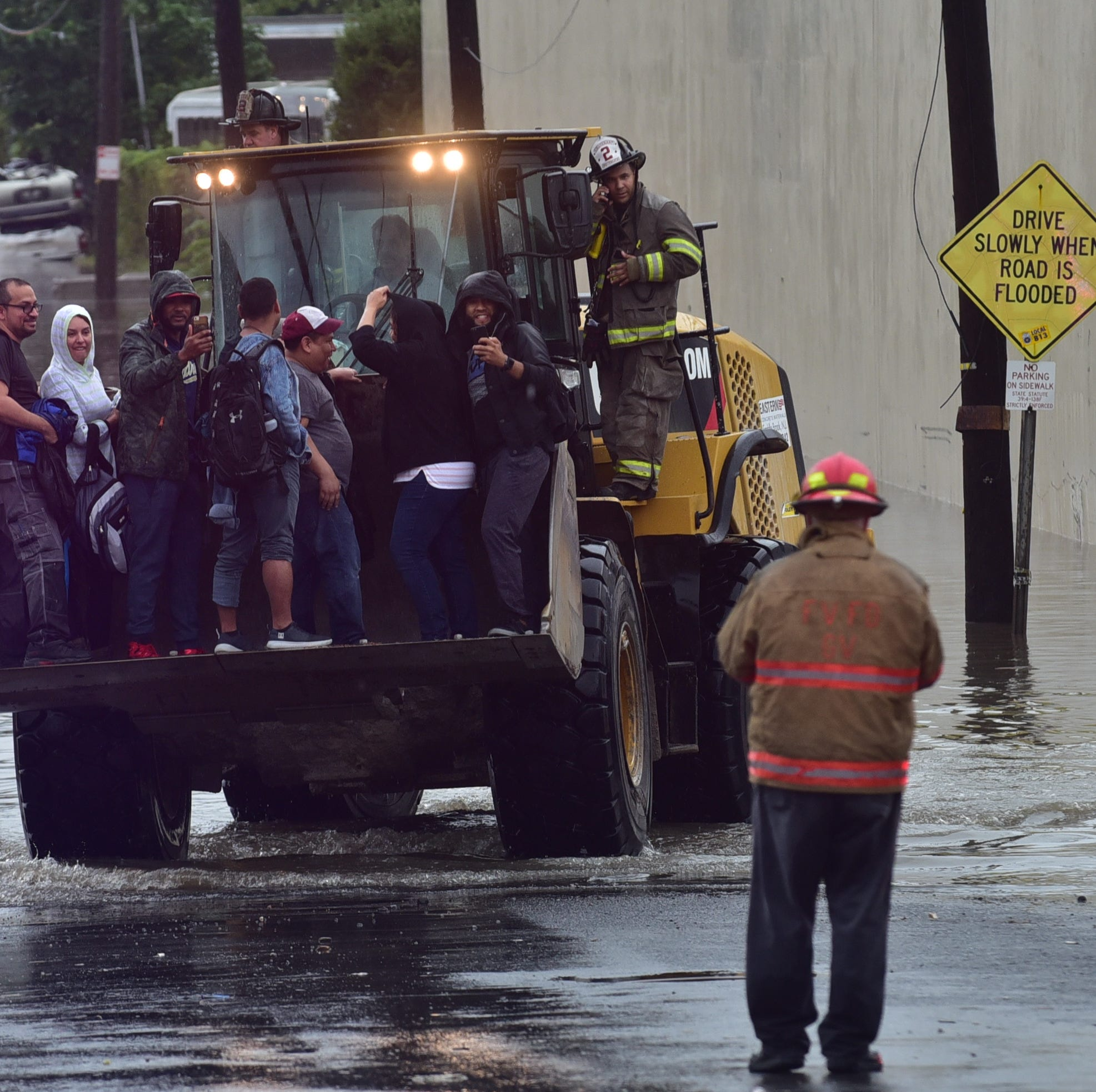 100 people rescued from flooded Fairview industrial building