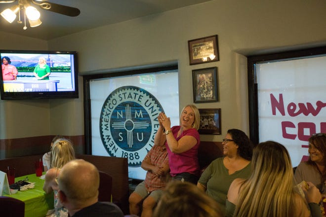 Kristy McDougall, center, laughs and cheers as friends and family join her to watch her compete on the game show wheel of fortune, Monday September 24, 2018 at The Game Bar and Grill.