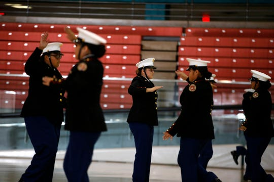 Members of the Shiprock High School Marine Corps Junior ROTC drill team perform Tuesday during a rally for Gaining Early Awareness and Readiness for Undergraduate Programs, GEAR UP, at the Chieftain Pit in Shiprock.