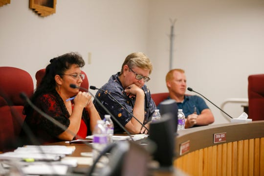 Bloomfield Mayor Cynthia Atencio, left, and City Councilors Ken Hare and Matt Pennington listen to public comments Monday during a meeting at Bloomfield City Hall.