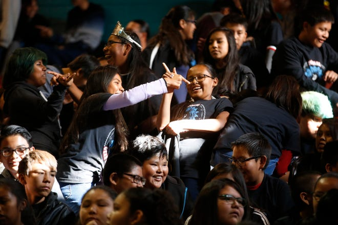 Students from Tsé Bit'a'í Middle School participate in a rally at the Chieftain Pit at Shiprock High School Tuesday for Gaining Early Awareness and Readiness for Undergraduate Programs, also known as GEAR UP, a program to help increase the number students wishing to further their education after high school.