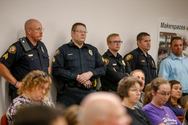 Members of the Bloomfield Police Department listen during a Bloomfield City Council meeting Monday at City Hall.