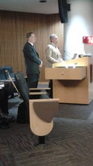 Kevin Adell addresses the Novi City Council on Monday, Sept. 24. Dan LeClair of GreenTech Engineering is at his side.