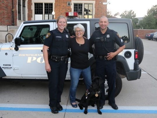 Trainer Carla Grava with Bella and Birmingham Police Officer Casey Pedersen and  Sgt. Joseph Bunting.