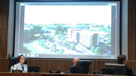 Novi City Council members watch a video of the proposed Adell Center development.