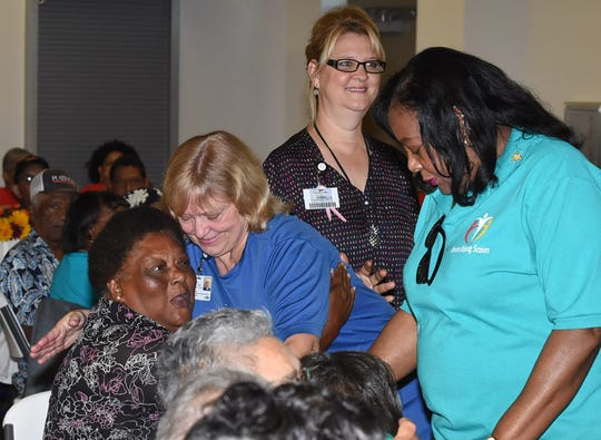 Theresa Stelly of LHC Group gives a hug to a senior citizen at Sunset's Seniors Helping Seniors event.