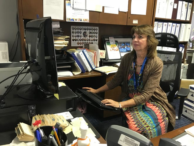 Kim Wyard works in her office at a Northeast Valley Health Corporation office in San Fernando, California, Aug. 17, 2018.