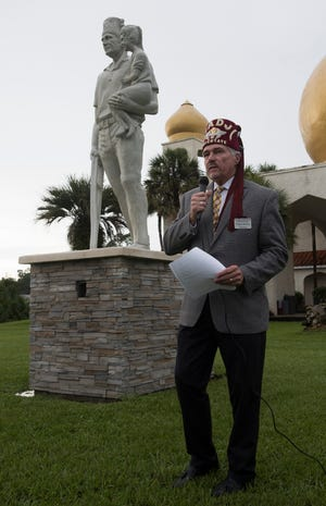 Carlos Baxley, the Potentate of the Hadji Temple on Nine Mile Road, helps to dedicate the Shriners new Silent Messenger statue during a ceremony at the temple on Monday, Sept. 24, 2018.