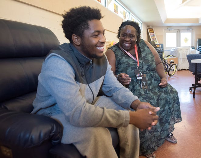 Keyon English describes events that landed him in trouble and his admiration for Evelyn Webber, the program director for at-risk youths at the Dorrie Miller Community Center.