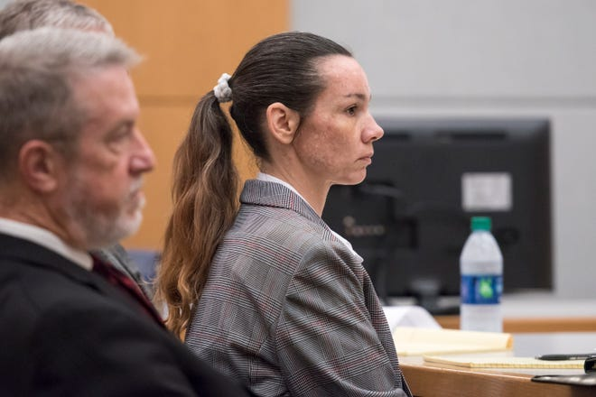 Mary Rice and her attorneys listen to the opening statement by prosecutor Bridgette Jensen during her trial at the Escambia County Courthouse in Pensacola on Tuesday, September 25, 2018.