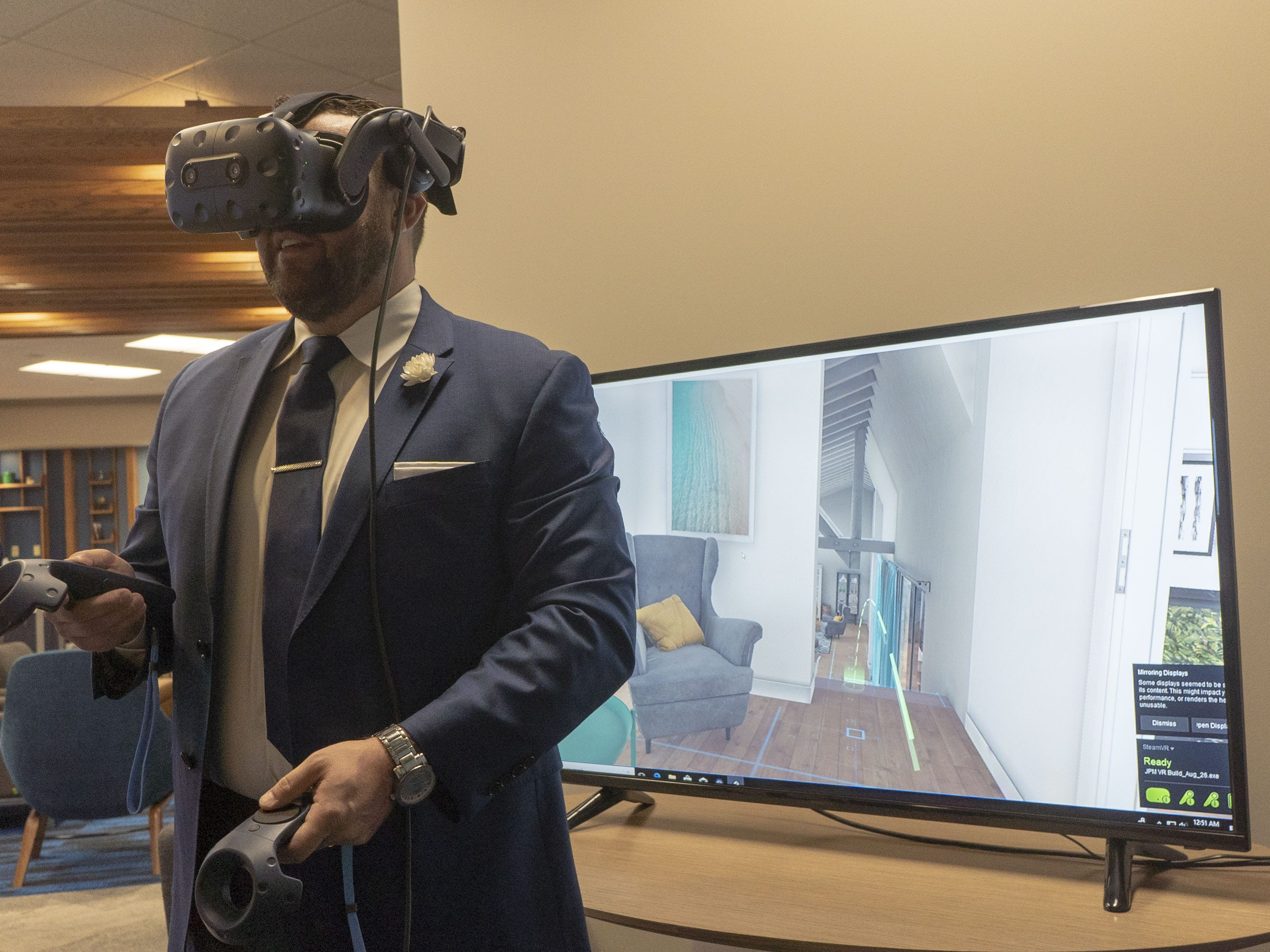 Chase Lending Manager Tyson Coon demonstrates a virtual-reality home-shopping service for mortgage customers. The new program is being piloted in Scottsdale.