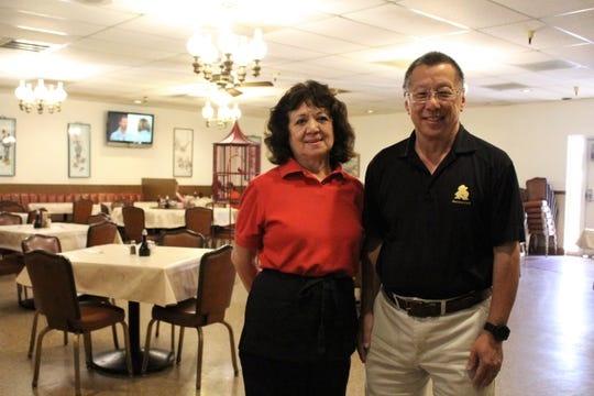 Owner Harlan Lee (right) poses with Margie Lucero, who has been a server at Sing High for more than 50 years.