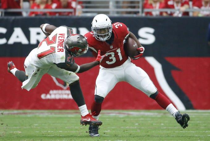 Arizona Cardinals running back David Johnson (31) stiff-arms  Tampa Bay Buccaneers cornerback Alterraun Verner (21)  in the first half of their Sept. 18, 2016, NFL game in Glendale.